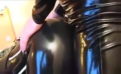 Latex Bondage With Breath Play